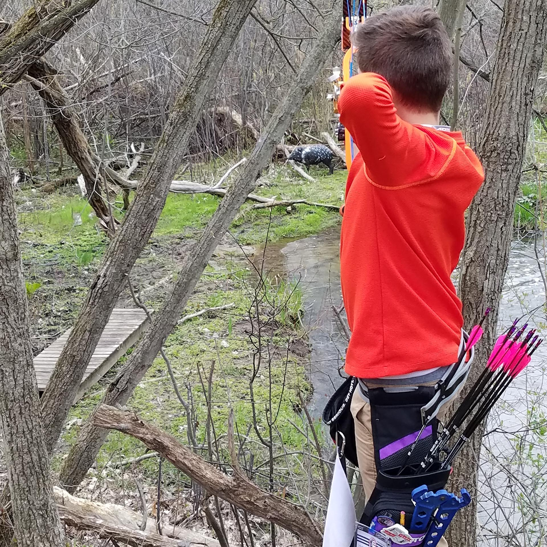 kid shooting deer dummy
